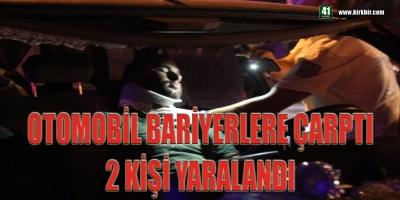 OTOMOBİL BARİYERLERE ÇARPTI 2 KİŞİ YARALANDI