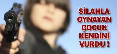 SİLAHLA OYNAYAN ÇOCUK KENDİNİ VURDU!